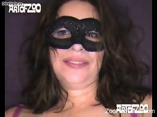 Sexy brunette in black mask is trying dog animal porn